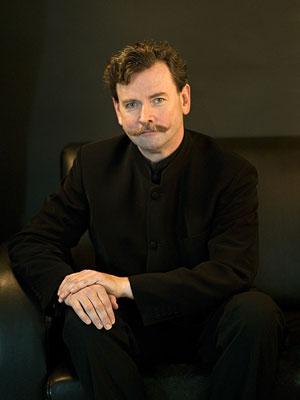 Dirigent Norbert Pfafflmeyer, fotografiert von Foto Schörg, Baden